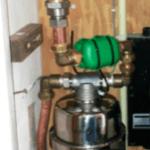 Combinatie van een waterfilter ontkalker en leiding watervitaliser